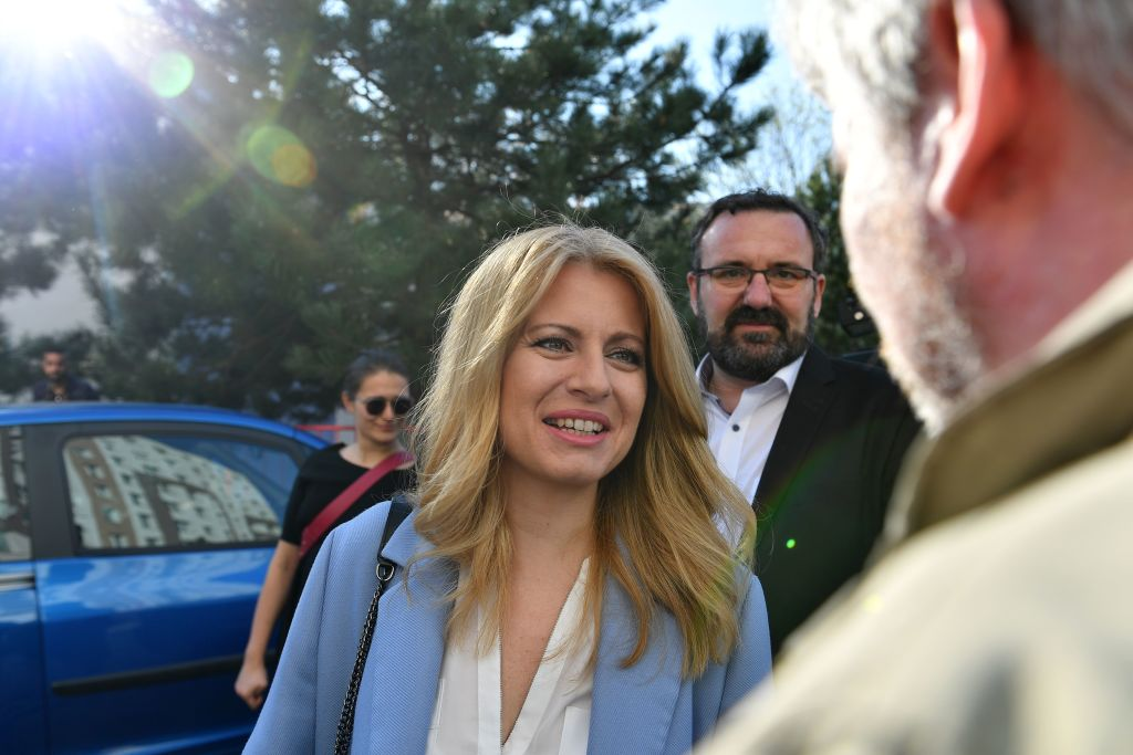 Presidential candidate Zuzana Caputova leaves with her partner Peter Konecny, after voting at a polling station in the town of Pezinok on March 30, 2019.