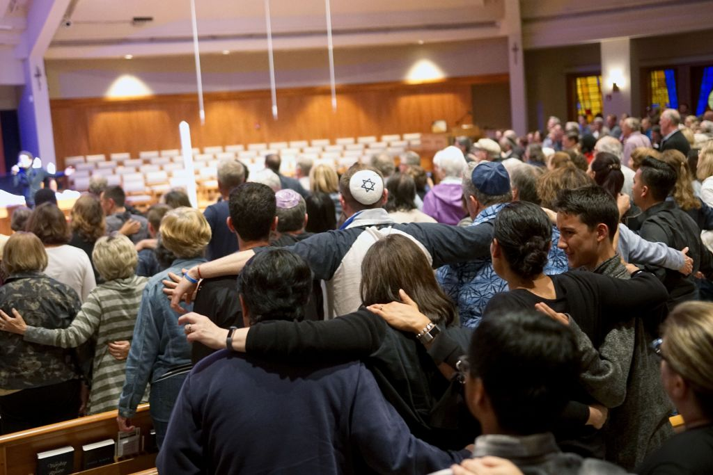 Mourners participate in a vigil for the victims of the Chabad of Poway Synagogue shooting at the Rancho Bernardo Community Presbyterian Church on April 27, 2019 in Poway, California.