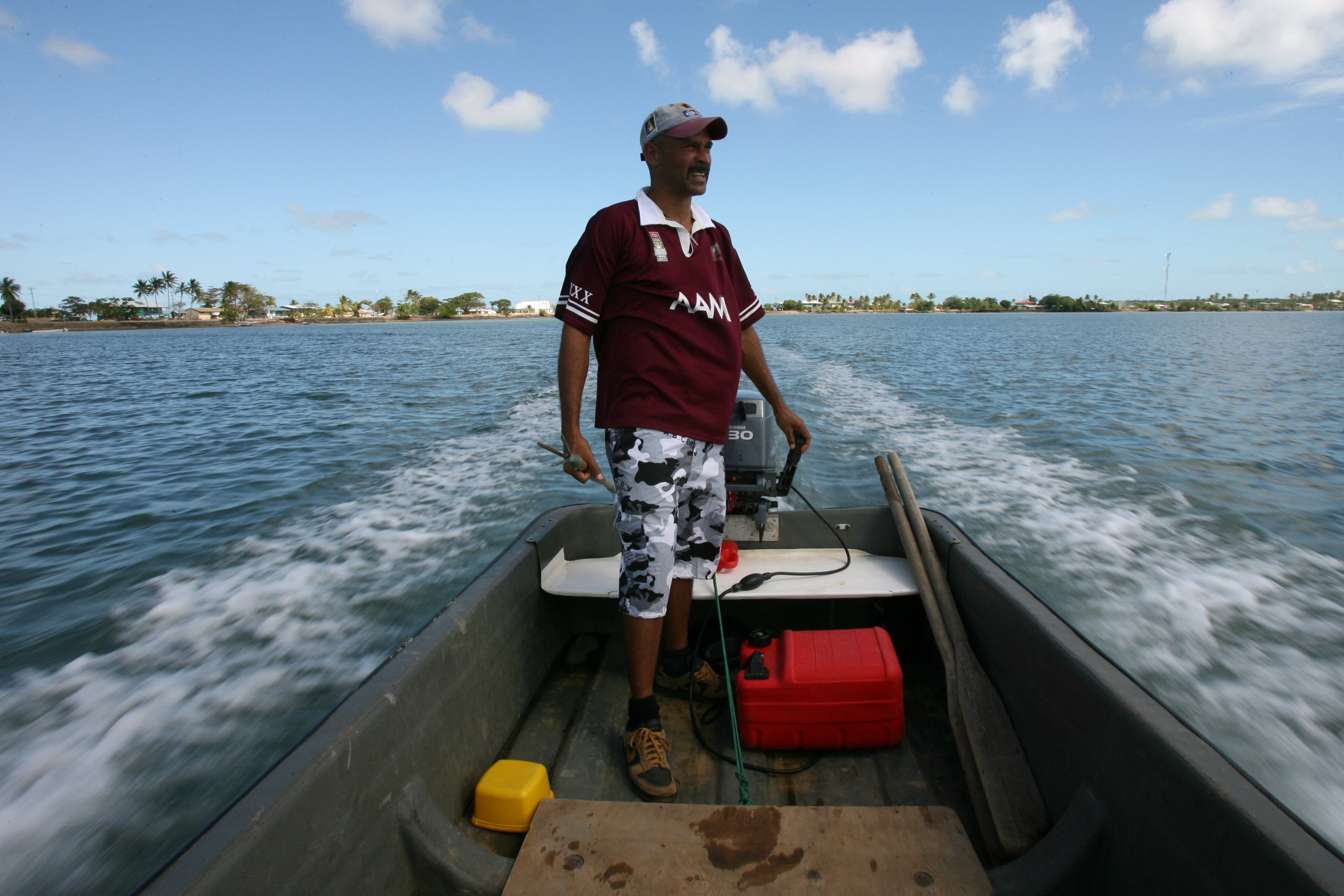 Jensen Warusam, from Saibai Island, on his boat in the Torres Strait.