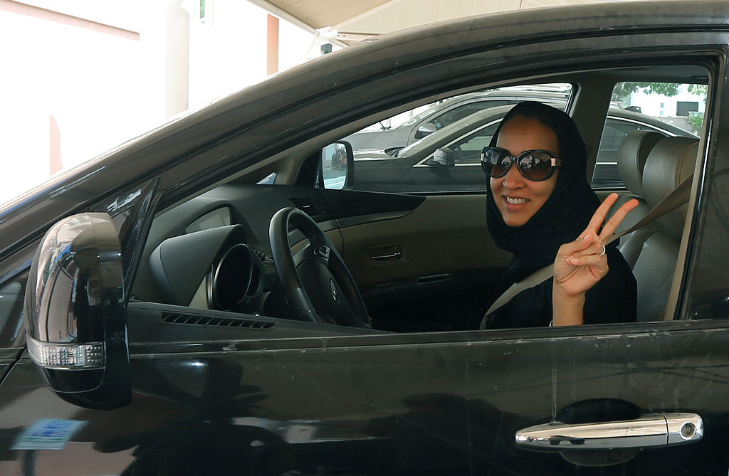 Saudi activist Manal Al Sharif flashes the sign for victory as she drives her car in Dubai on October 22, 2013, in solidarity with Saudi women preparing to take to the wheel on October 26, defying the Saudi authorities, to campaign women's right to drive in Saudi Arabia.