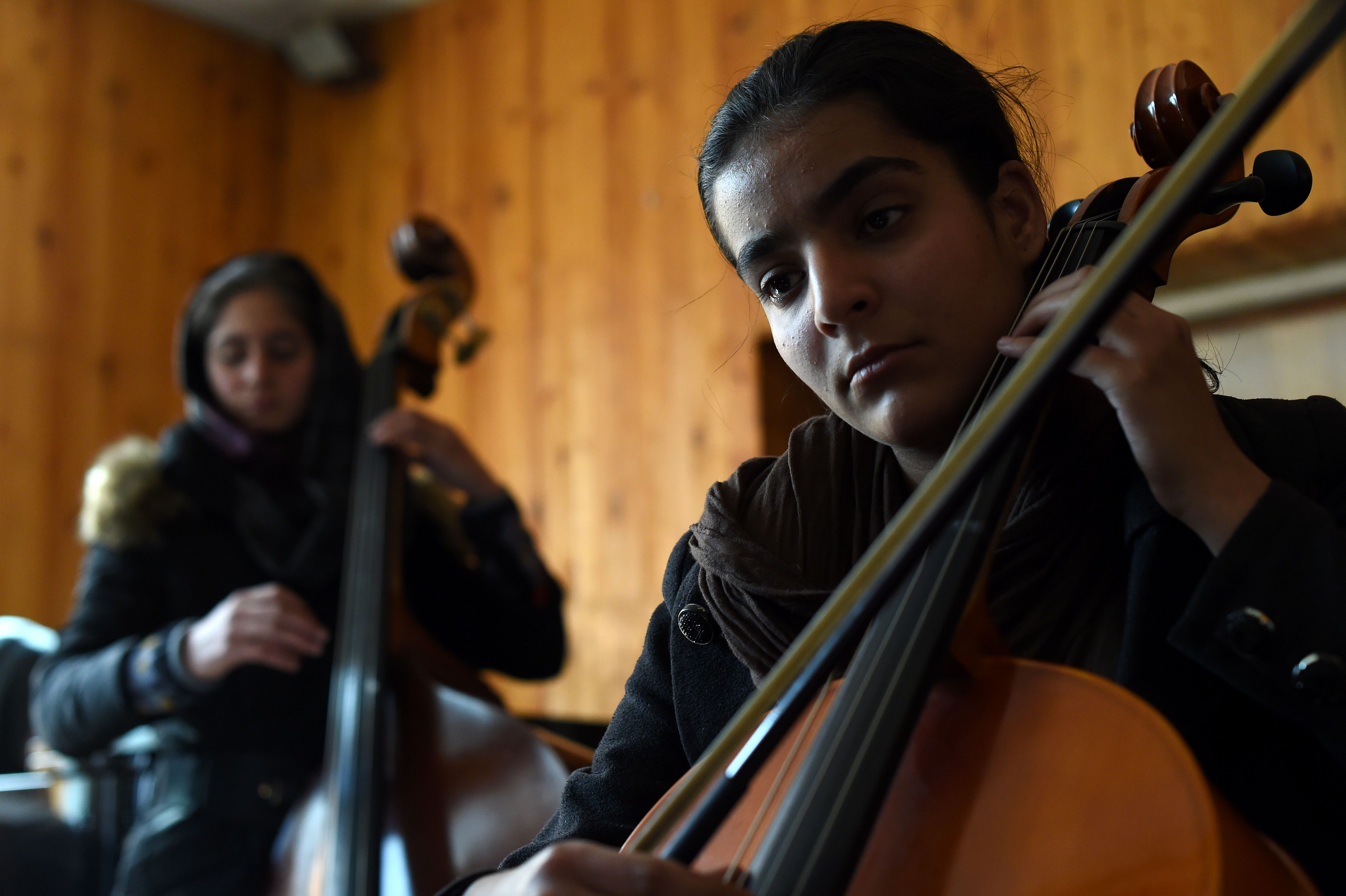 In this photograph taken on January 8, 2017, Afghan music students play during a rehearsal at The Afghanistan National Institute of Music in Kabul.