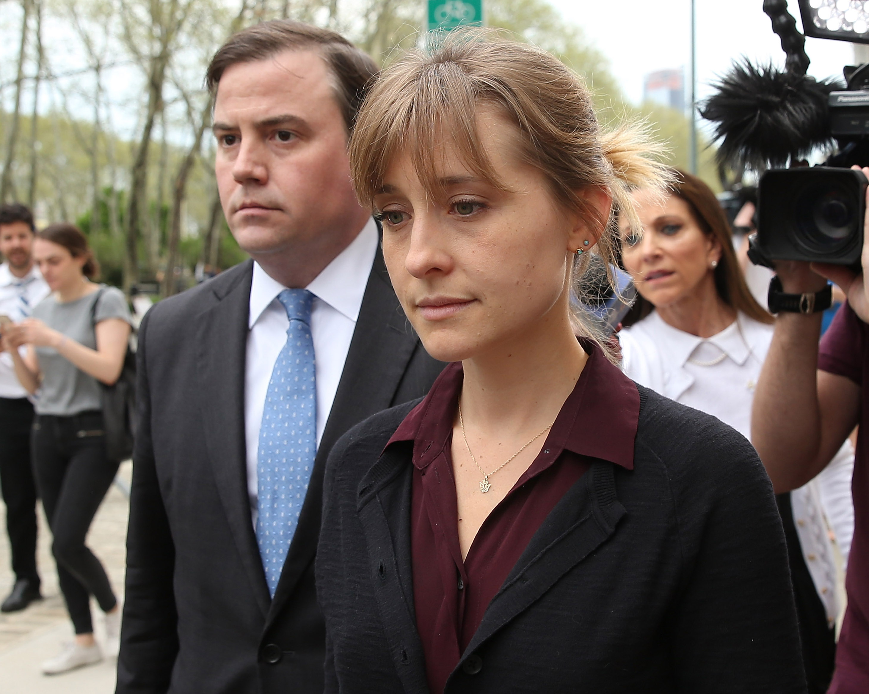 Allison Mack, right, departs the United States Eastern District Court in 2019.