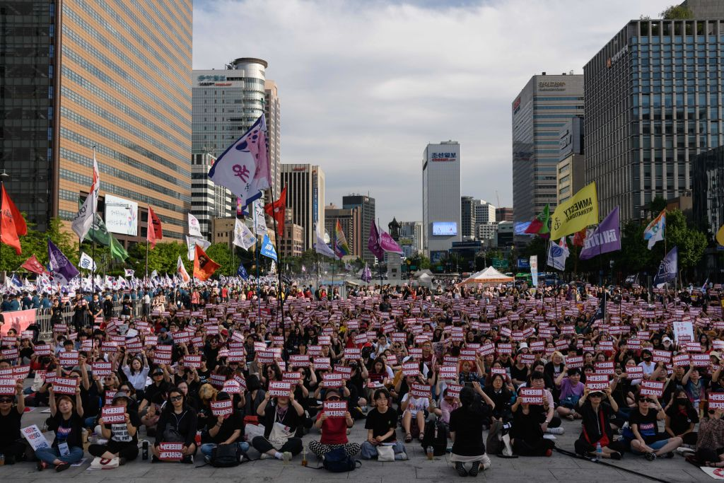 Protesters hold placards reading 'Abolish punishment for abortion' as they protest South Korean abortion laws in Gwanghwamun plaza in Seoul on July 7, 2018.