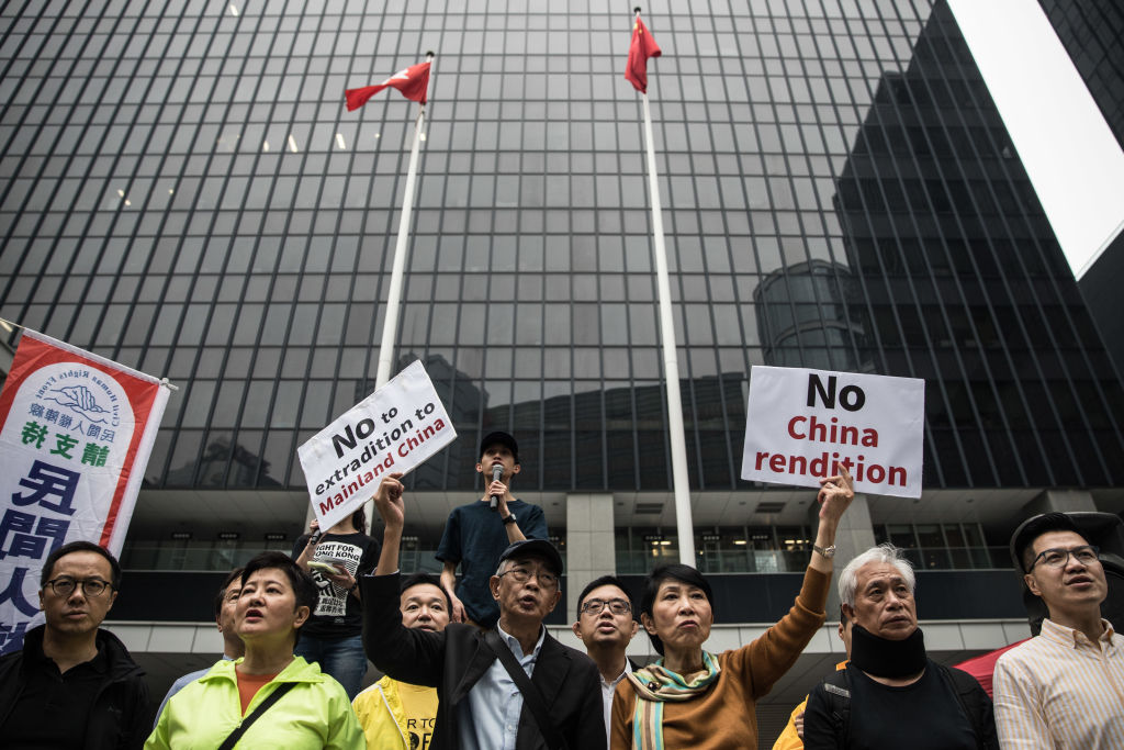Demonstrators protest against the new Hong Kong extradition law outside the government headquarters in Admiralty, Hong Kong on March 31, 2019.