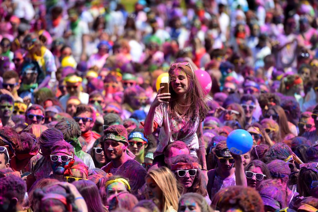Runners attend a DJ concert after finishing the Burdi Colors race on May 5, 2018 in Pessac, southwestern France.