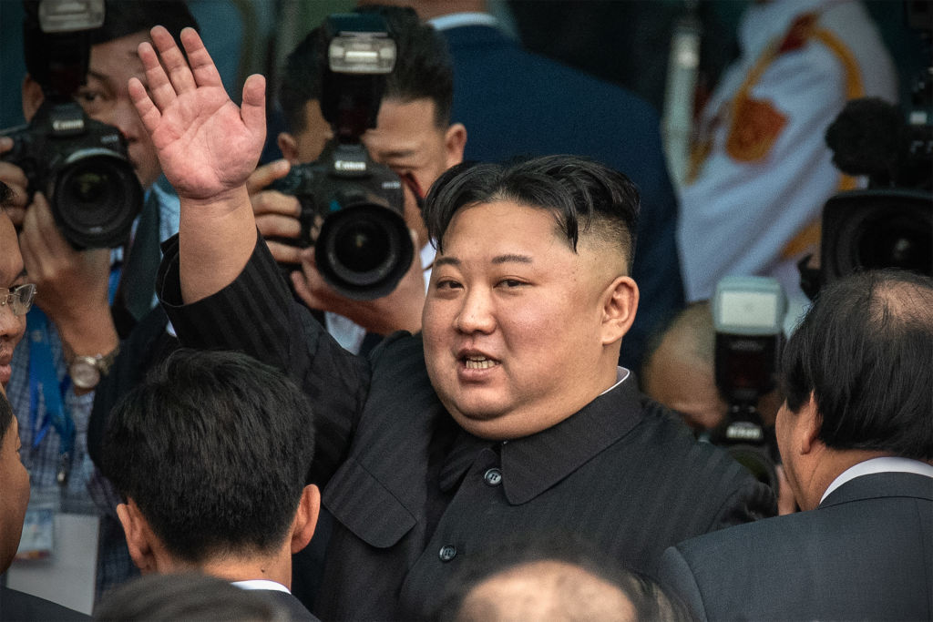 Kim Jong-un waves as he prepares to leave Vietnam after the Hanoi summit in Dong Dang, Vietnam, on March 2, 2019.