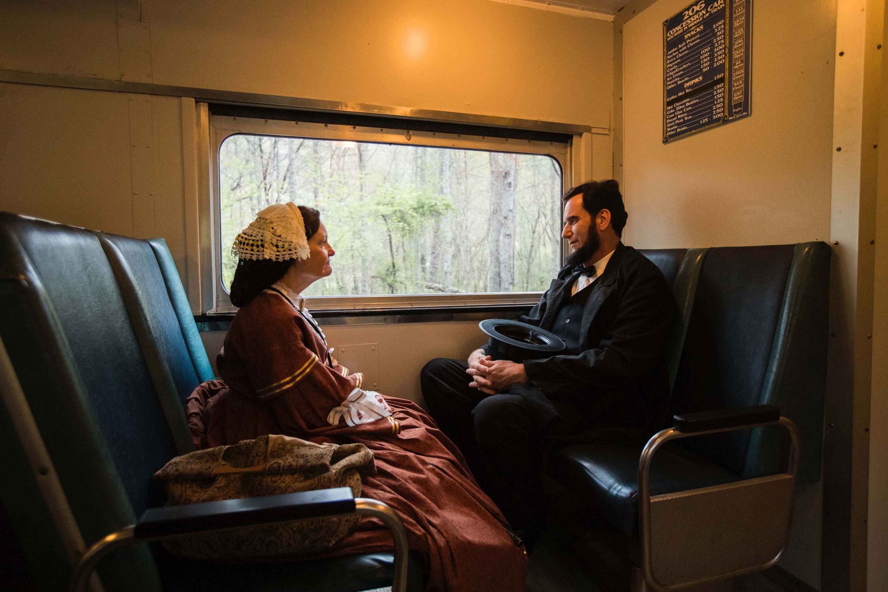 Members of the Lincoln Presenters conference take the scenic and historic train from Blue Ridge to McCaysville on April 12. Here, Teena Baldrige, 67, of Springboro, Ohio, chats with James Mitchell, 54, from Hope, Kan.