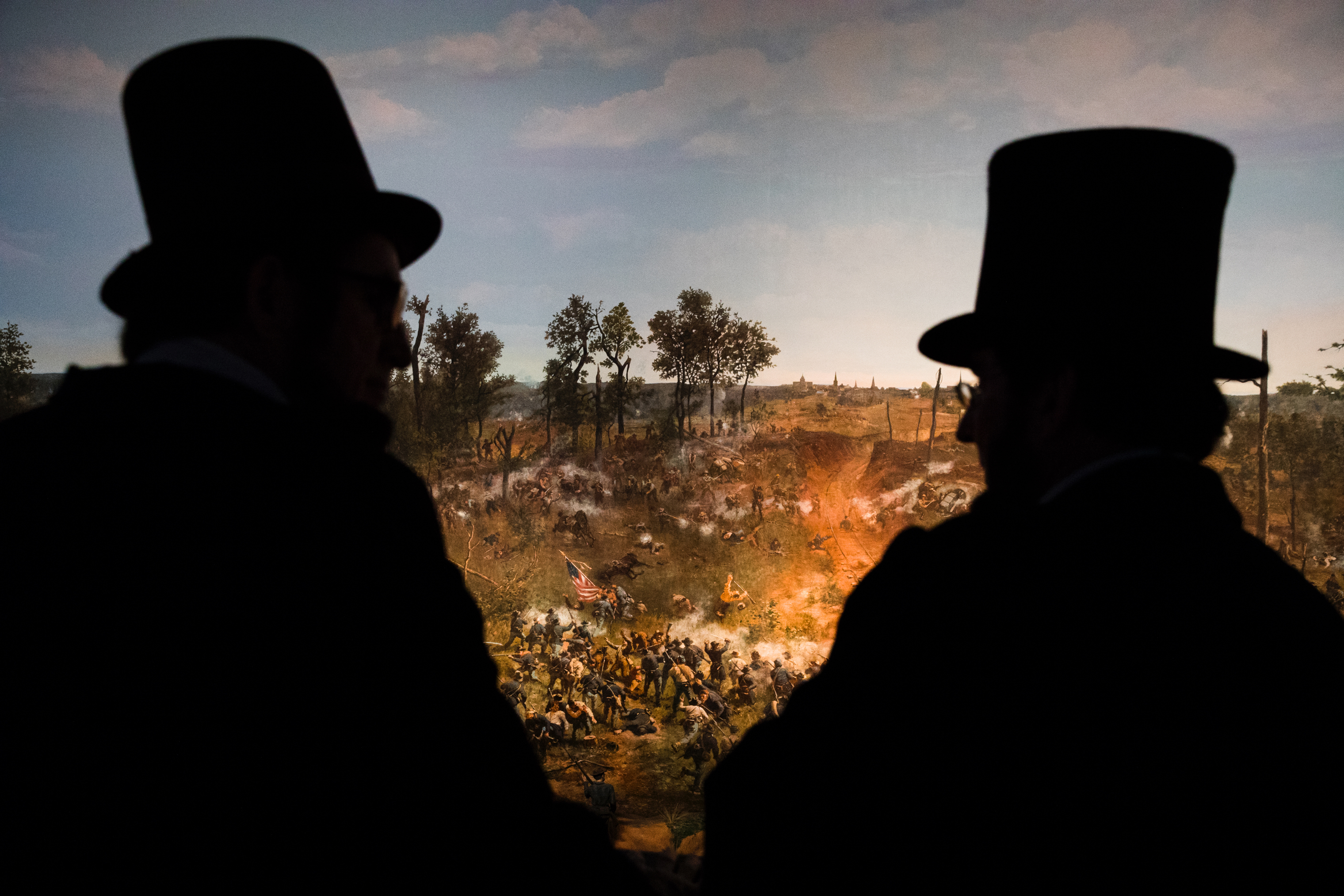 Several Abe Lincolns walk around the Atlanta History Center, where they viewed a restored cyclorama of the 1864 Battle of Atlanta, on April 13.