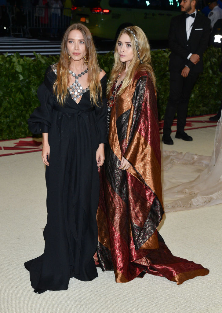 Mary-Kate Olsen (L) and Ashley Olsen attend the Heavenly Bodies: Fashion & The Catholic Imagination Costume Institute Gala at the Metropolitan Museum of Art on May 7, 2018 in New York City.