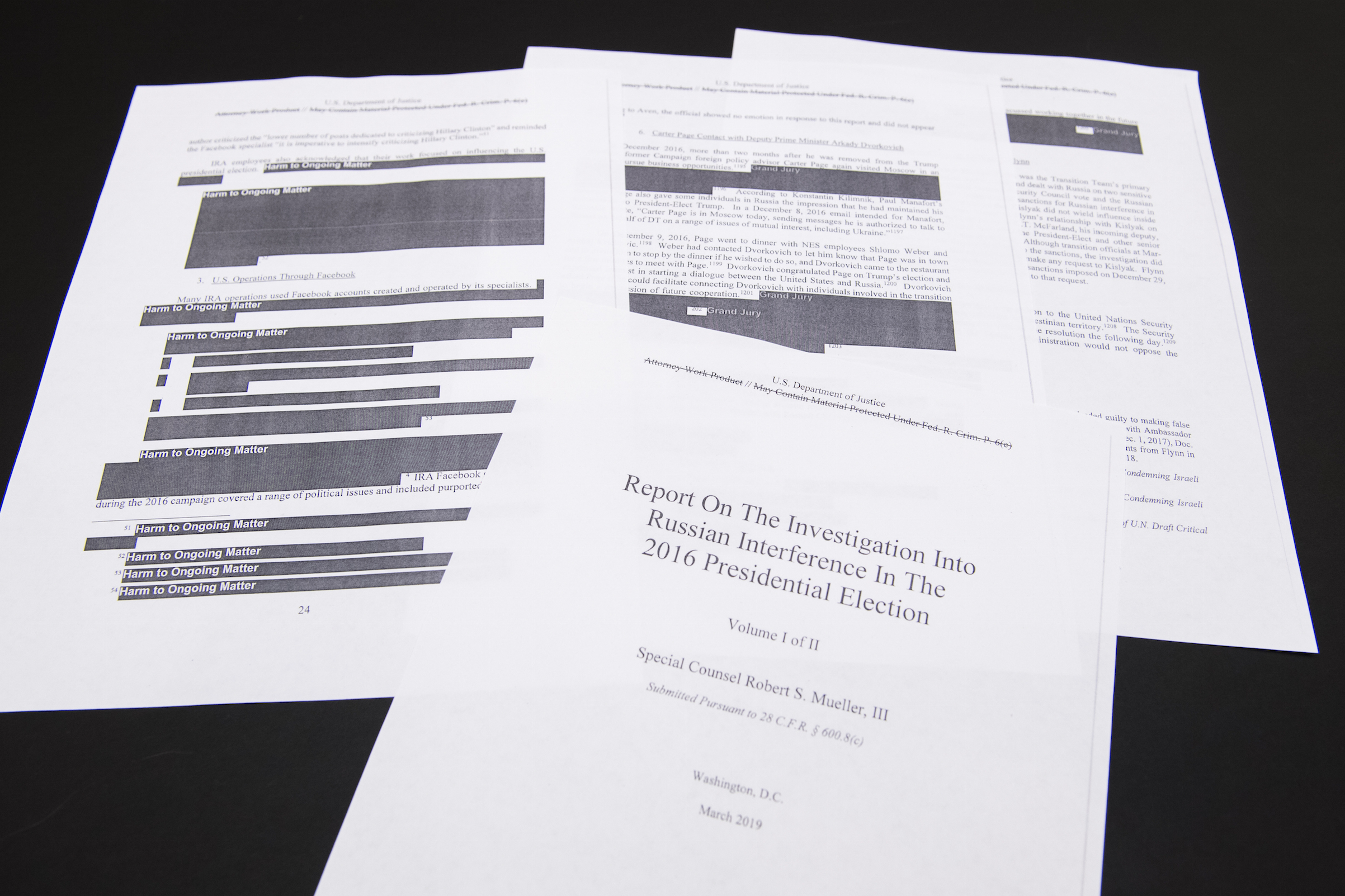 A few pages of special counsel Robert Mueller's report on Russian interference in the 2016 election, which was printed out by staff in the House Judiciary Committee's hearing room on April 18, 2019.