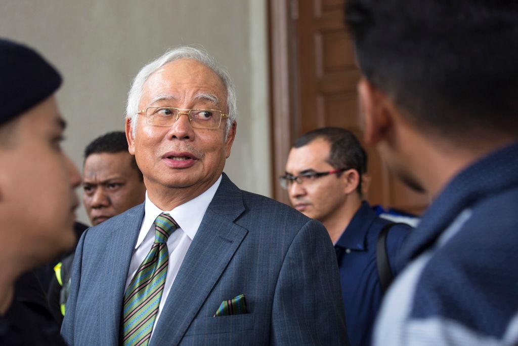 Malaysia's former Prime Minister Najib Razak exits the Kuala Lumpur High Court in Kuala Lumpur, Malaysia on Aug. 8, 2018.