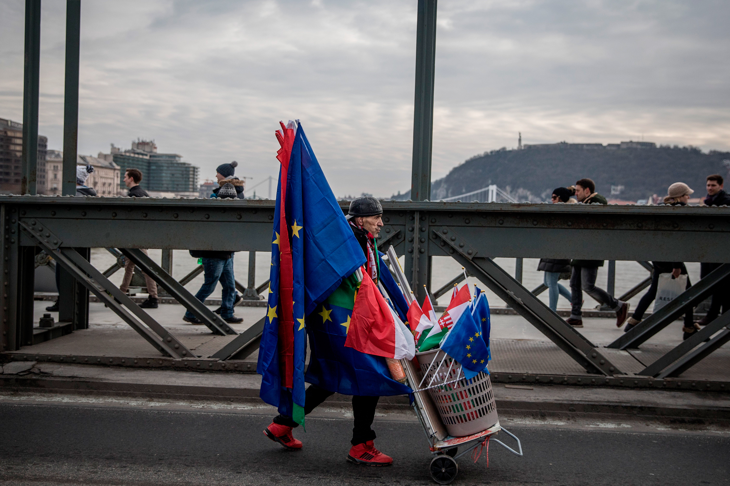 A man sells both Hungarian and E.U. flags in Budapest at a January protest against Orban's government
