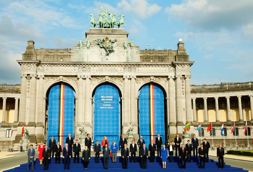 NATO heads of state and government pose for a family photo in front of the Arcades du Cinquantenaire ahead of the dinner within the 2018 NATO Summit on July 11, 2018 in Brussels, Belgium.
