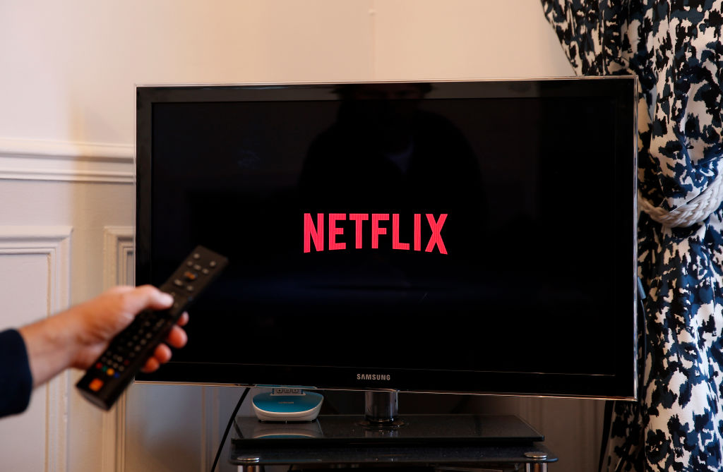 Photo illustration of the Netflix media service provider's logo is displayed on the screen of a television on October 23, 2018 in Paris, France.
