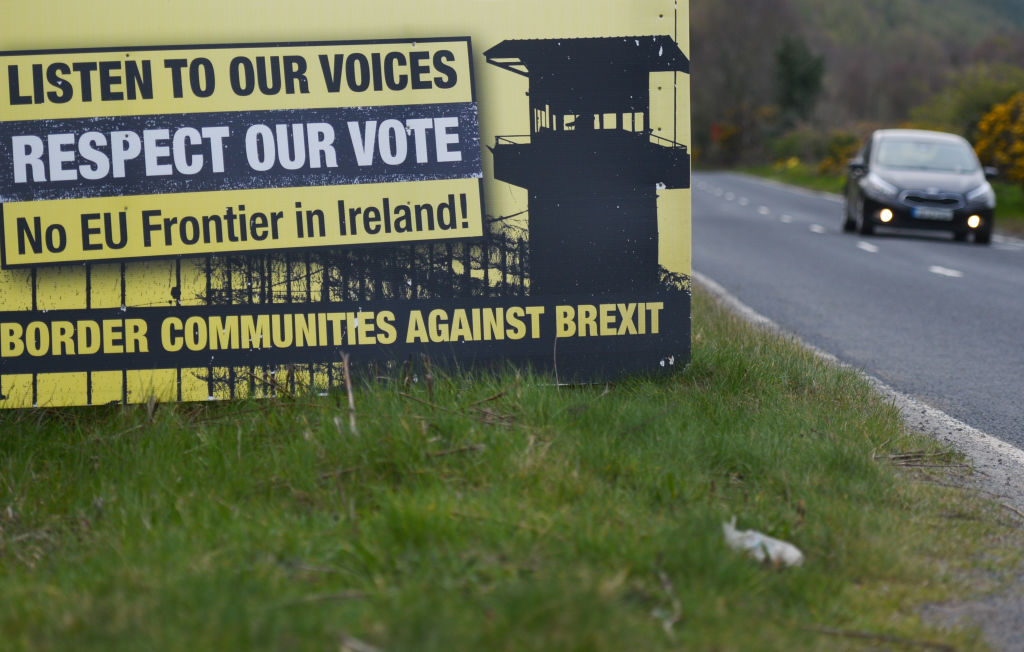 A car passes a poster by the anti-brexit campaign group 'Border communities against Brexit' on the road between Omeath and Newry, as it crosses the border between the Republic of Ireland and the United Kingdom.