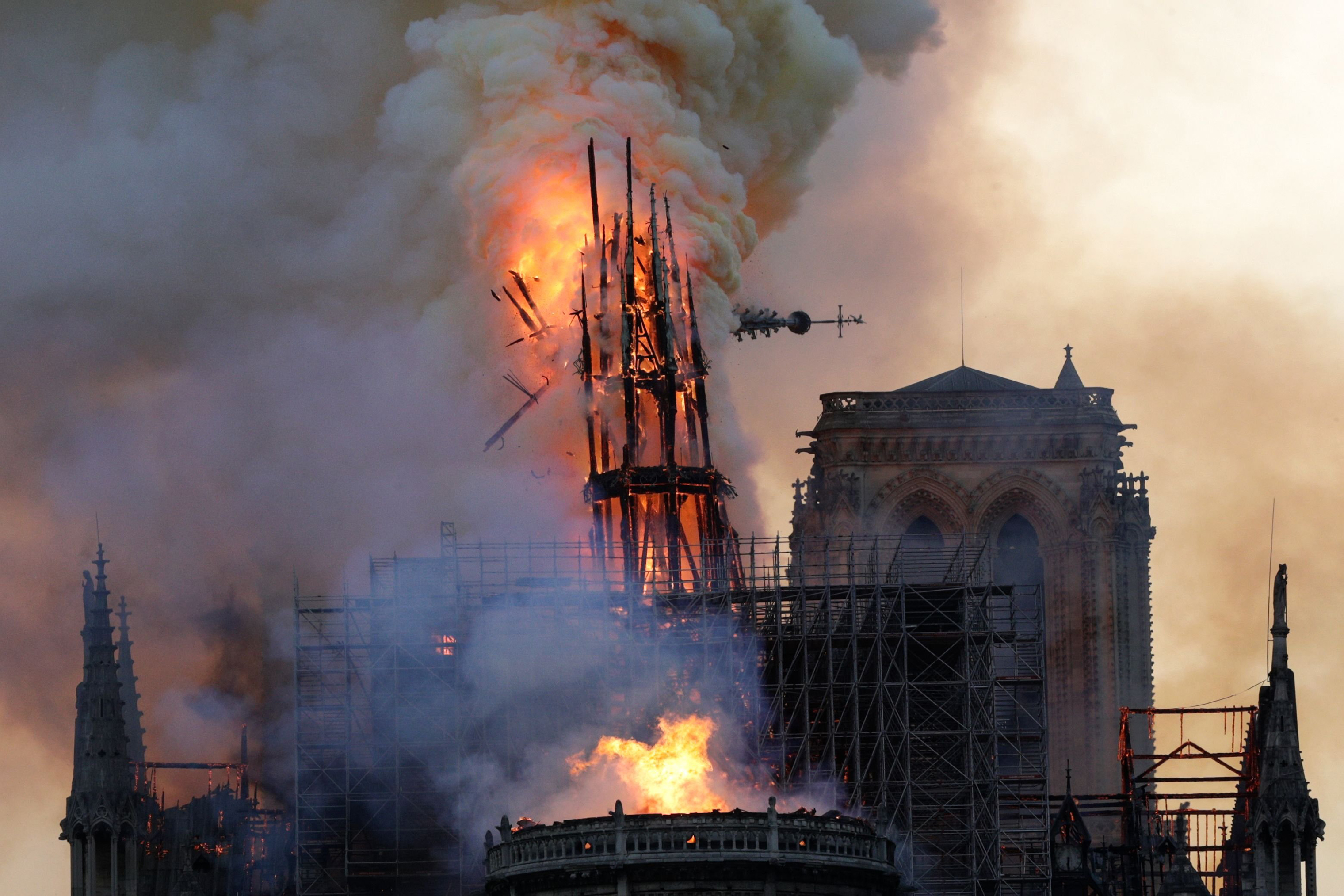 The steeple collapses as smoke and flames engulf the Notre-Dame Cathedral in Paris on April 15, 2019.