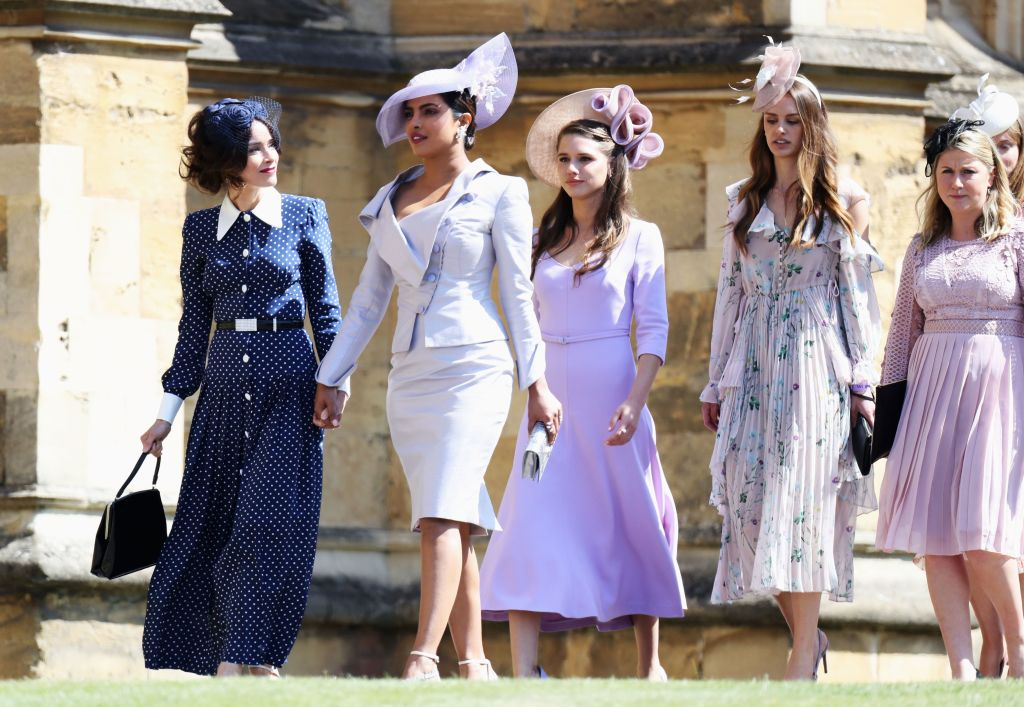 Abigail Spencer (L) and Priyanka Chopra (2L) arrive for the wedding ceremony of Britain's Prince Harry, Duke of Sussex and US actress Meghan Markle at St George's Chapel, Windsor Castle, in Windsor, on May 19, 2018.