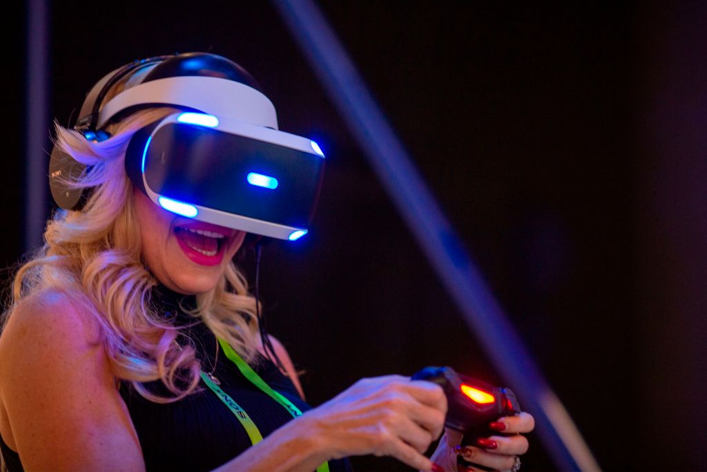 A woman plays ASTRO BOT Rescue Mission at a Playstation VR display at the Sony Exhibit at the Las Vegas Convention Center during CES 2019 in Las Vegas on January 9, 2019.