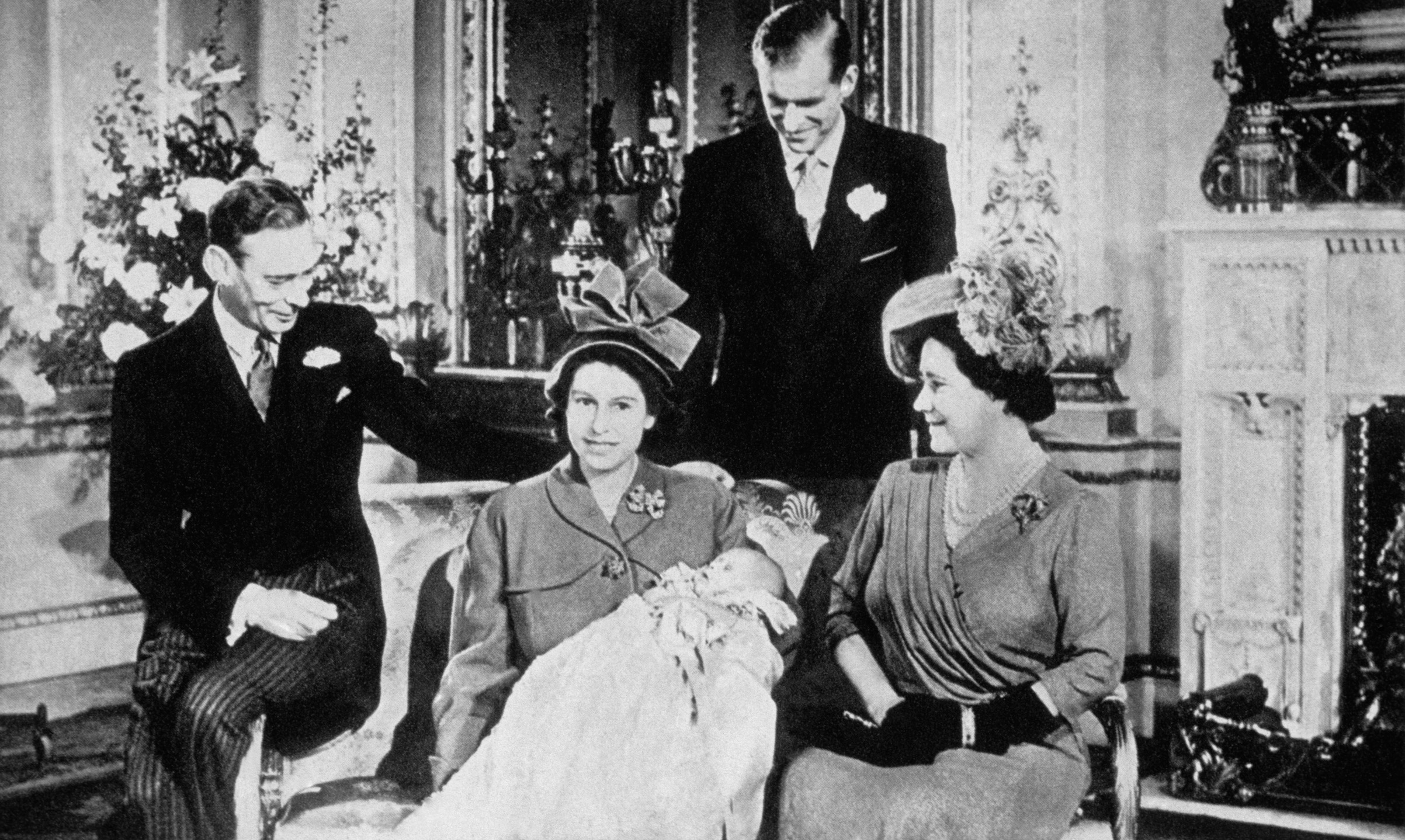 King George VI and his wife Queen Elizabeth, the Princess Elizabeth — the future Queen Elizabeth II — with the Duke of Edinborough and the infant Prince Charles.