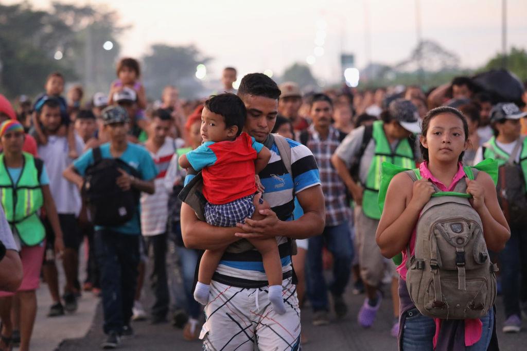 Members of a migrant caravan walk into the interior of Mexico after crossing the Guatemalan border near Ciudad Hidalgo, Mexico on Oct. 21, 2018.
