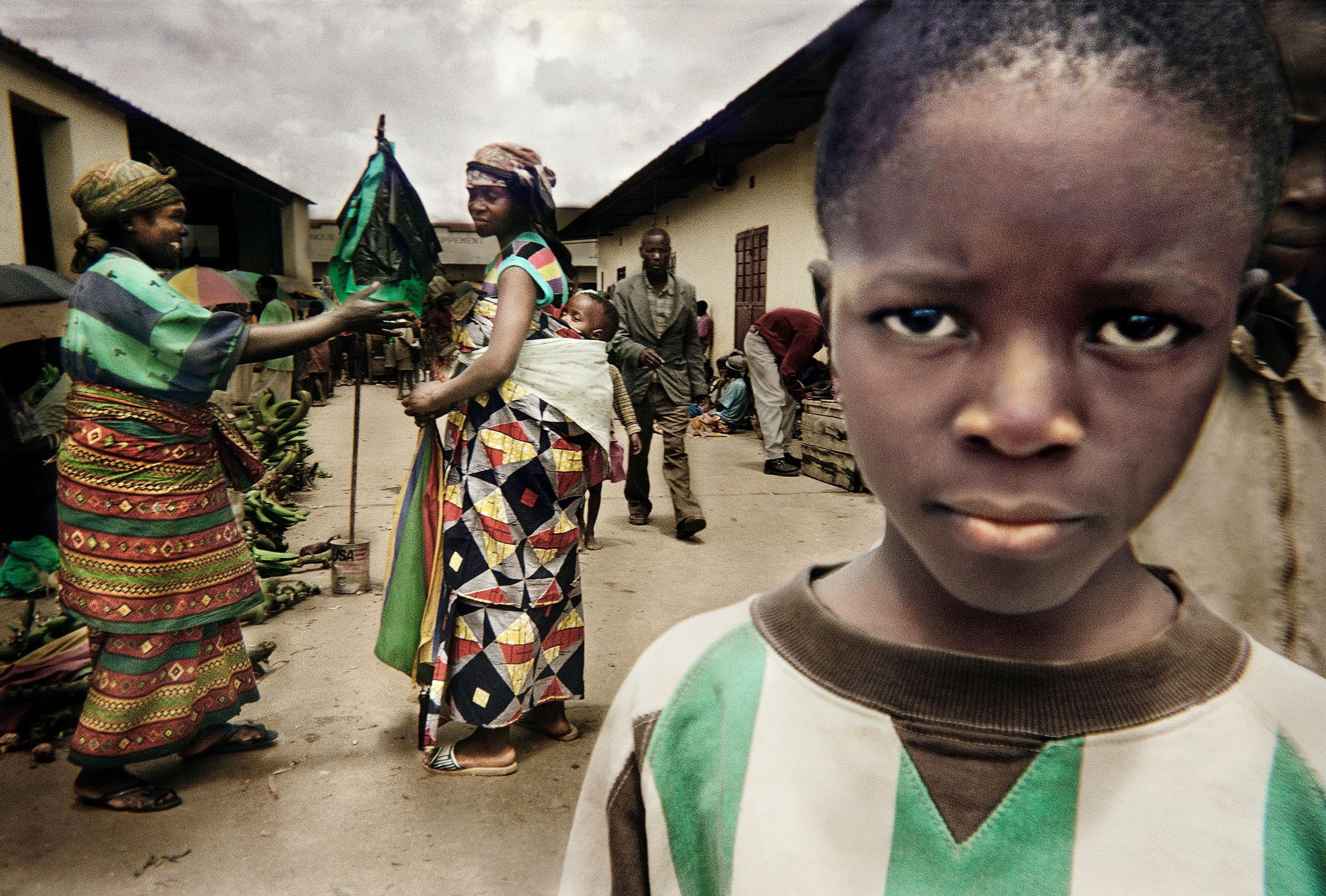 Portrait of Gadi Habumugisha taken at the market, made by one of the  camera kids , Jacqueline Niyonkuru, when she was 8 years old.