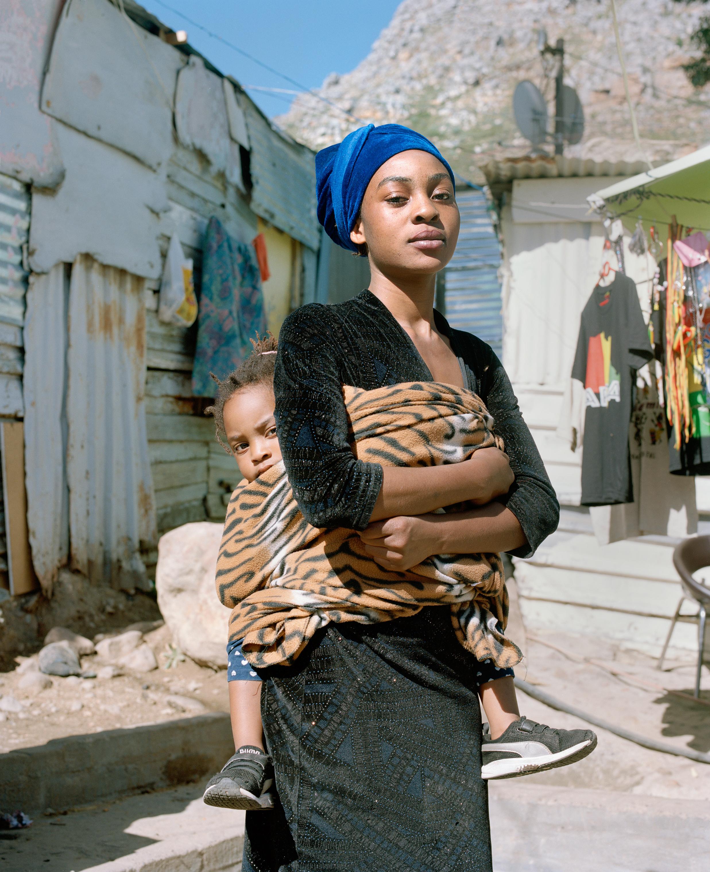 Natasha Manda, 20, and her daughter, Grace. Manda has been living in Imizamo Yethu for three years.