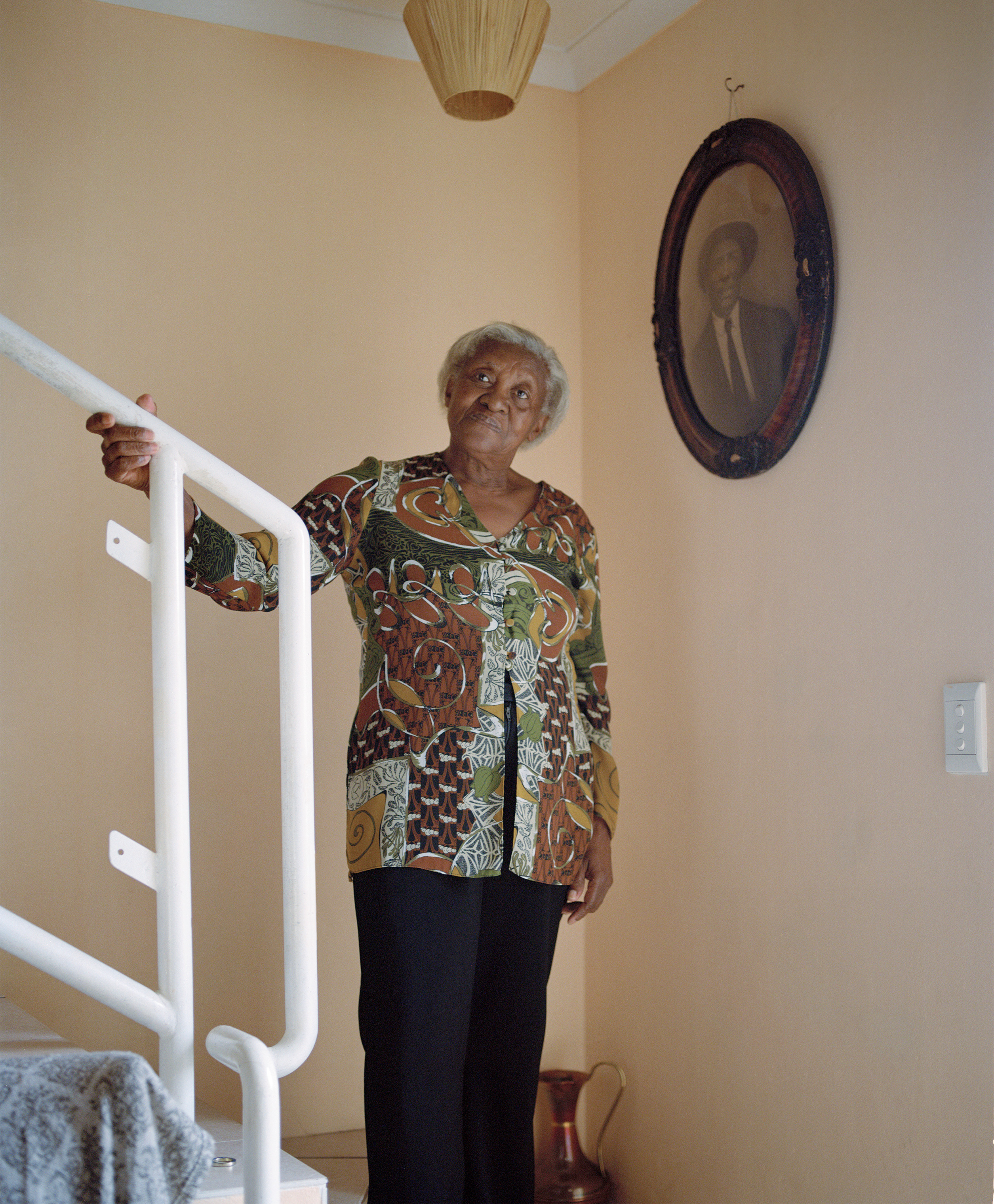 Susan Lewis, 76, is a resident of Cape Town's District Six neighborhood. Under the apartheid regime, the area was deemed  whites only,  and the community's 60,000 residents were forcibly removed. Today, only 139 homes, including Lewis's, have been rebuilt for the community's former residents.