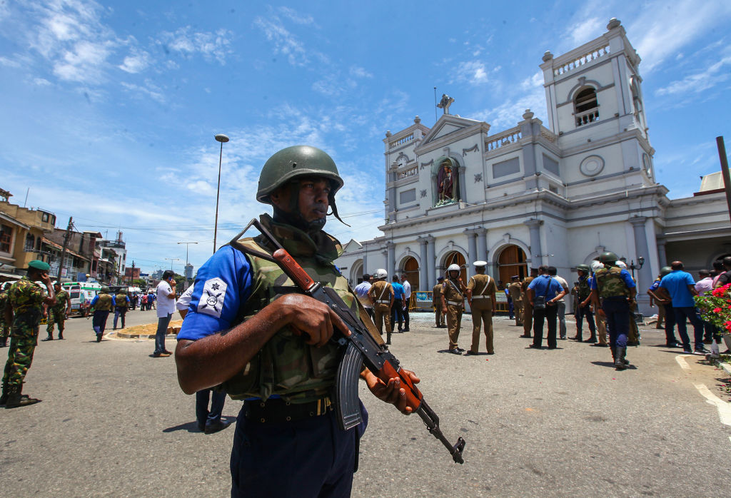 Sri Lankan security forces secure the area around St. Anthony's Shrine after an explosion hit St Anthony's Church in Kochchikade on April 21, 2019 in Colombo, Sri Lanka.