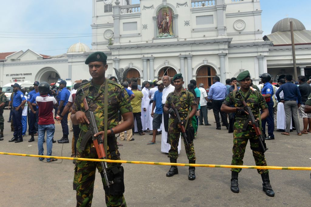 Sri Lankan security personnel keep watch outside the church premises following a blast at the St. Anthony's Shrine in Kochchikade in Colombo on April 21, 2019.
