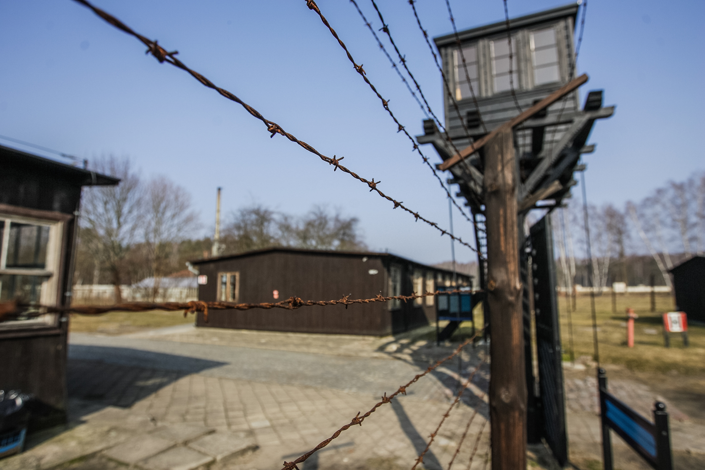 Barbed wire fence and watchtower are seen in former Nazi German Concentration Camp Stutthof on March 17, 2012,  in Sztutowo, Poland.