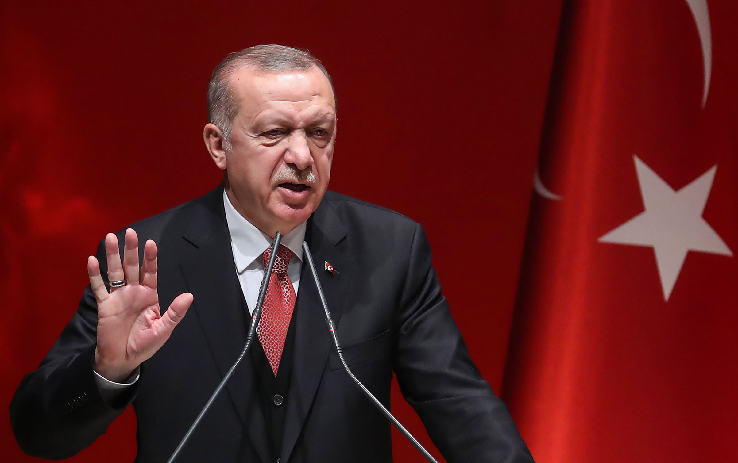 Turkish President Tayyip Erdogan addresses election officials on Jan. 29