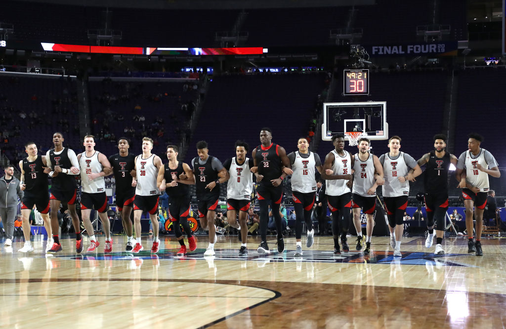 The Texas Tech Red Raiders run the court with linked arms during practice prior to the 2019 NCAA men's Final Four at U.S. Bank Stadium on April 5, 2019 in Minneapolis, Minnesota.