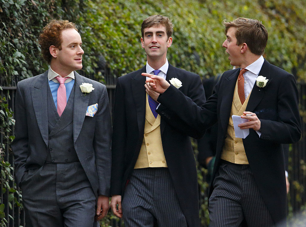 Tom Inskip (left) attends the wedding of Jake Warren and Zoe Stewart in the Wren Chapel at the Royal Hospital Chelsea on December 14, 2013 in London, England.