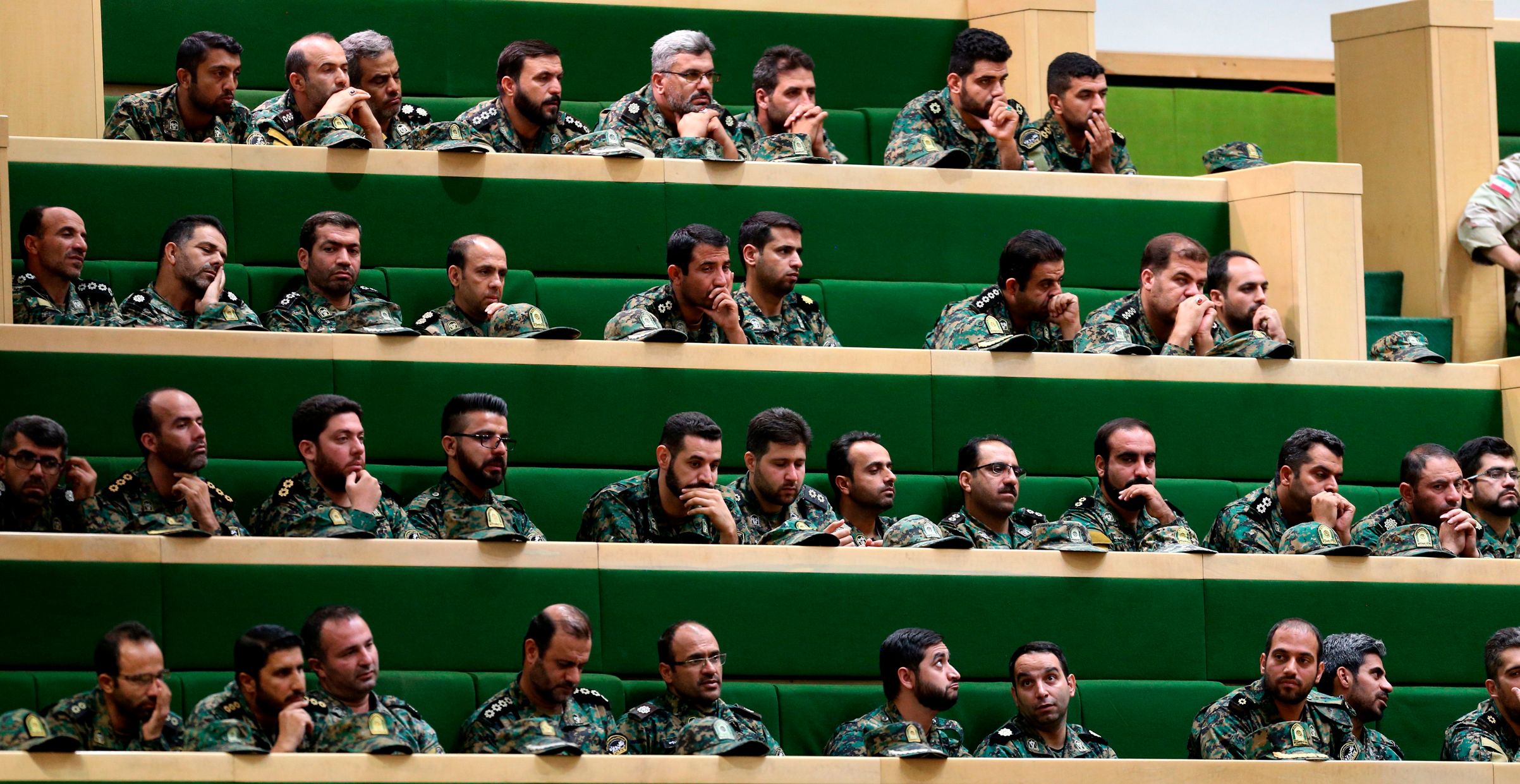 Members of the Iranian Revolutionary Guard Corps listen to a speech in parliament in Tehran on Oct. 7, 2018.