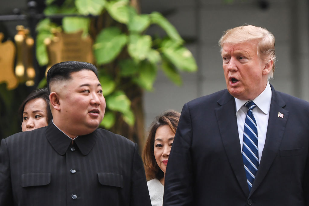 "US President Donald Trump walks with North Korea's leader Kim Jong Un during a break in talks at the second US-North Korea summit at the Sofitel Legend Metropole hotel in Hanoi on Feb. 28, 2019. Trump said relations with North Korea's Kim Jong Un remain ""very good"" after he suggested a third summit."