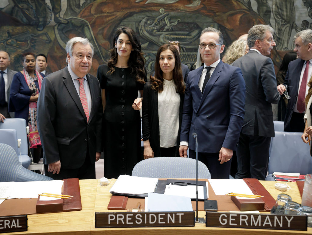 Secretary-General of the United Nations, Antonio Guterres, Human rights lawyer Amal Clooney, Iraqi human rights activist Nadia Murad Basee Taha and German Foreign Minister Heiko Maas attend a United Nations Security Council meeting at the U.N. headquarters in New York City on April 23, 2019.