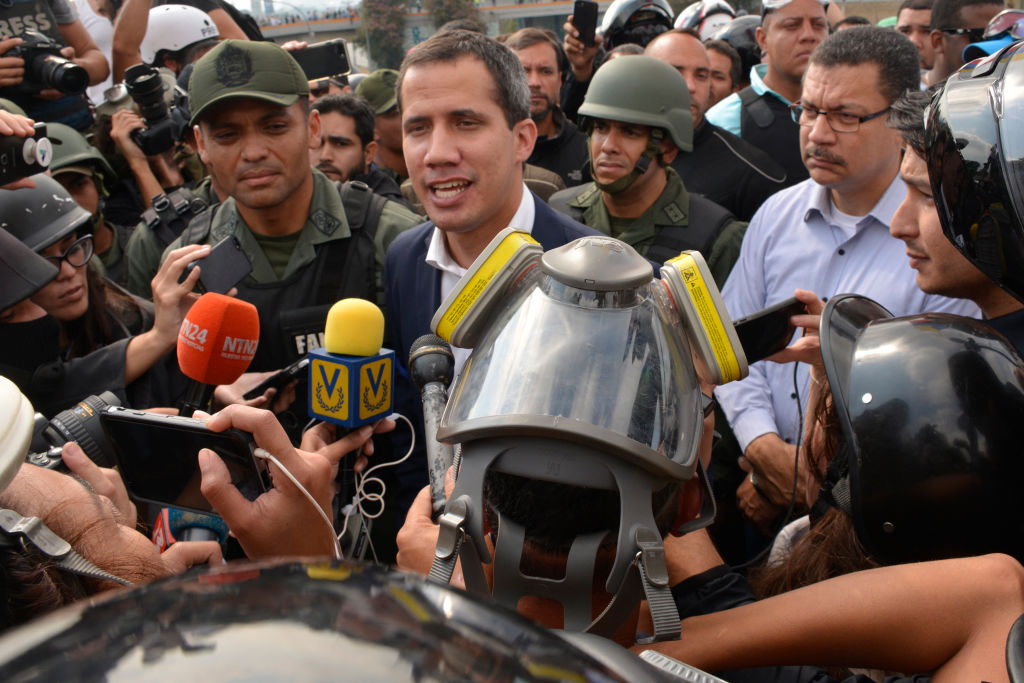 Venezuelan opposition leader Juan Guaidó, recognized by many members of the international community as the country's rightful interim ruler, talks to media out of air force base La Carlota on April 30, 2019 in Caracas, Venezuela. Through a live broadcast via social media, Venezuelan opposition leader Juan Guaido called for a military uprising against the government of Nicolás Maduro.