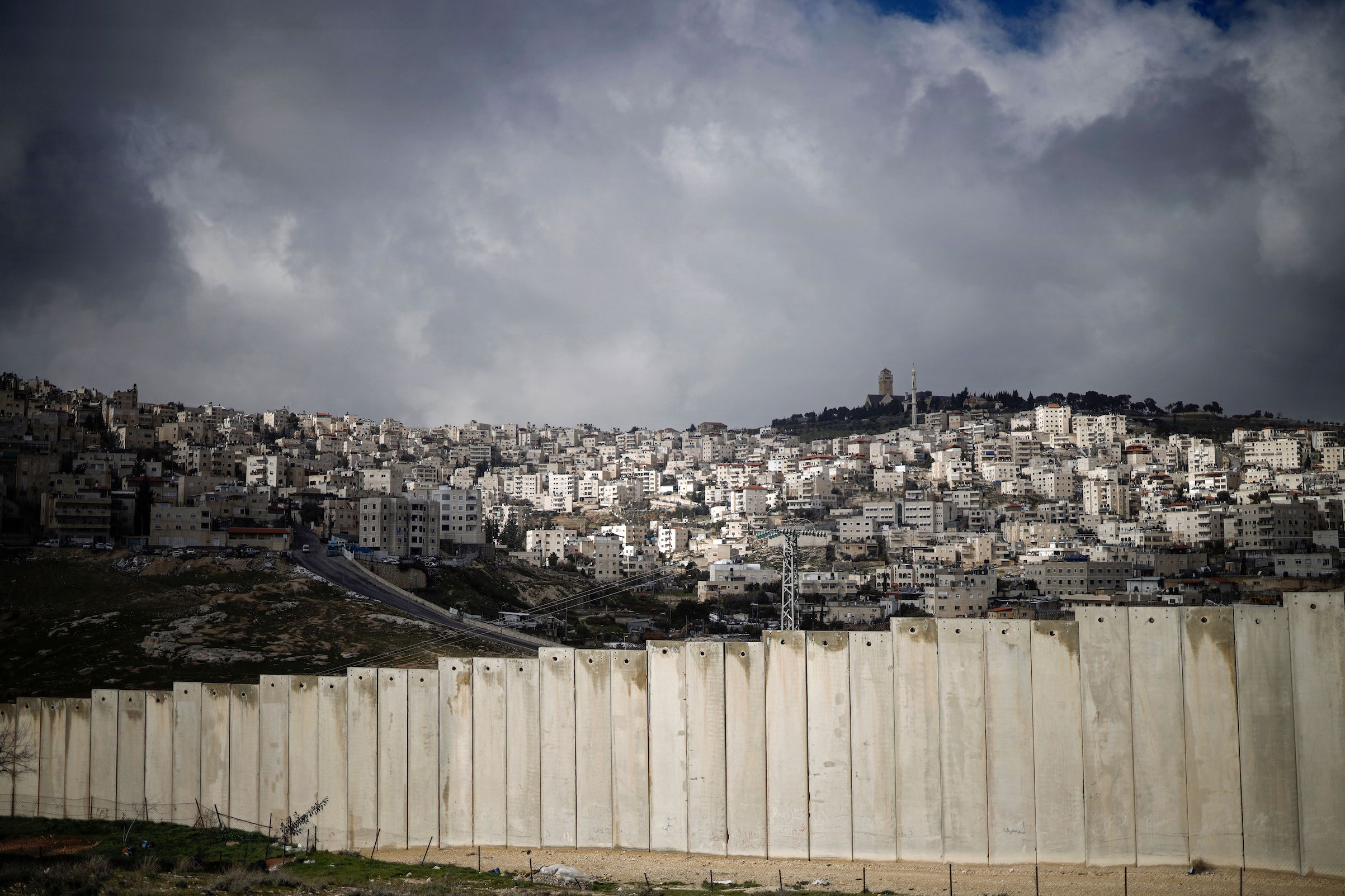 This picture taken on Jan. 17, 2019, shows the controversial barrier separating the Palestinian West Bank village of Eizariya (foreground) and Jerusalem (background).