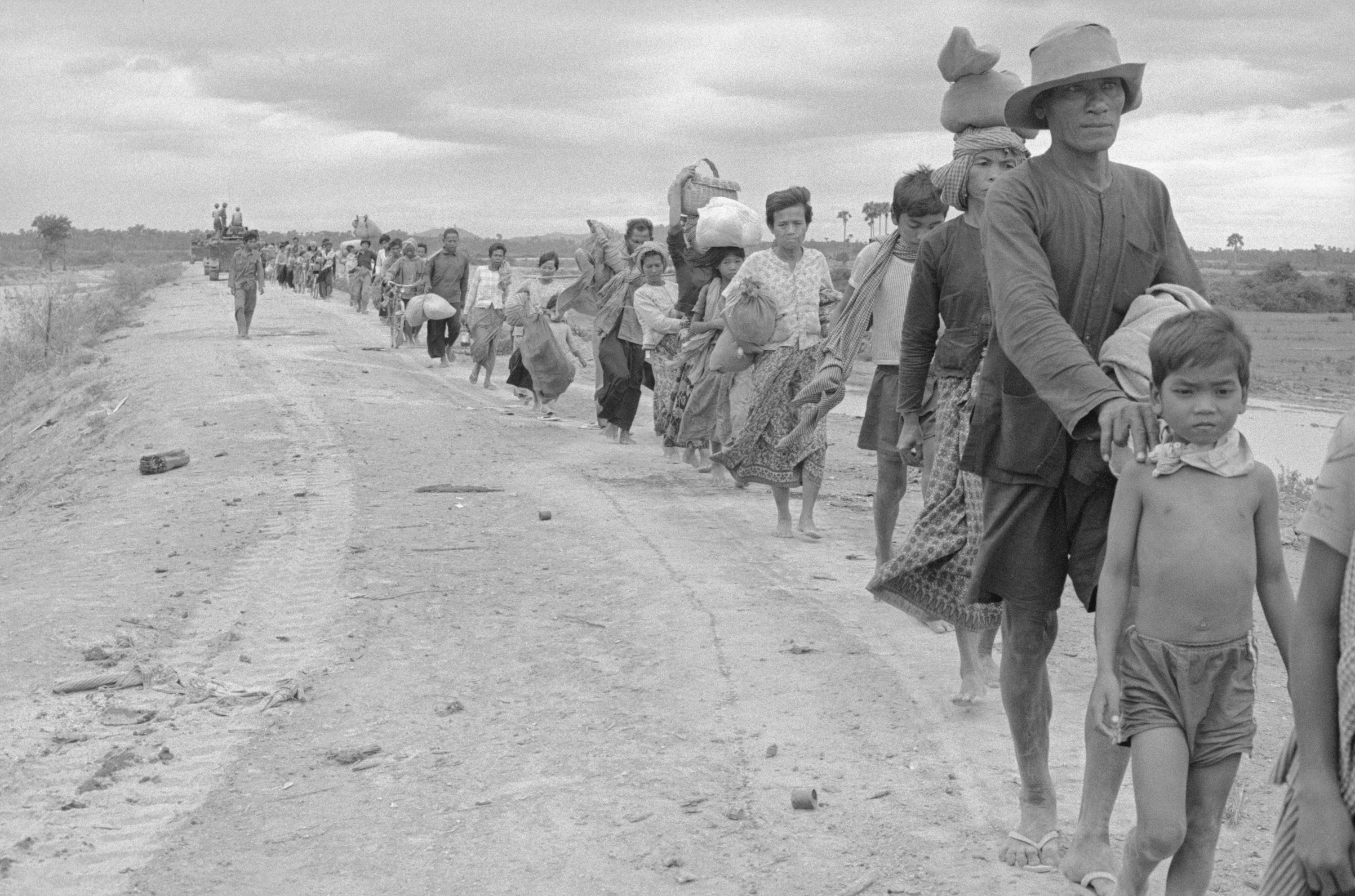Long lines of refugees on the move some 17 kilometers from the capital in Cambodia in 1975