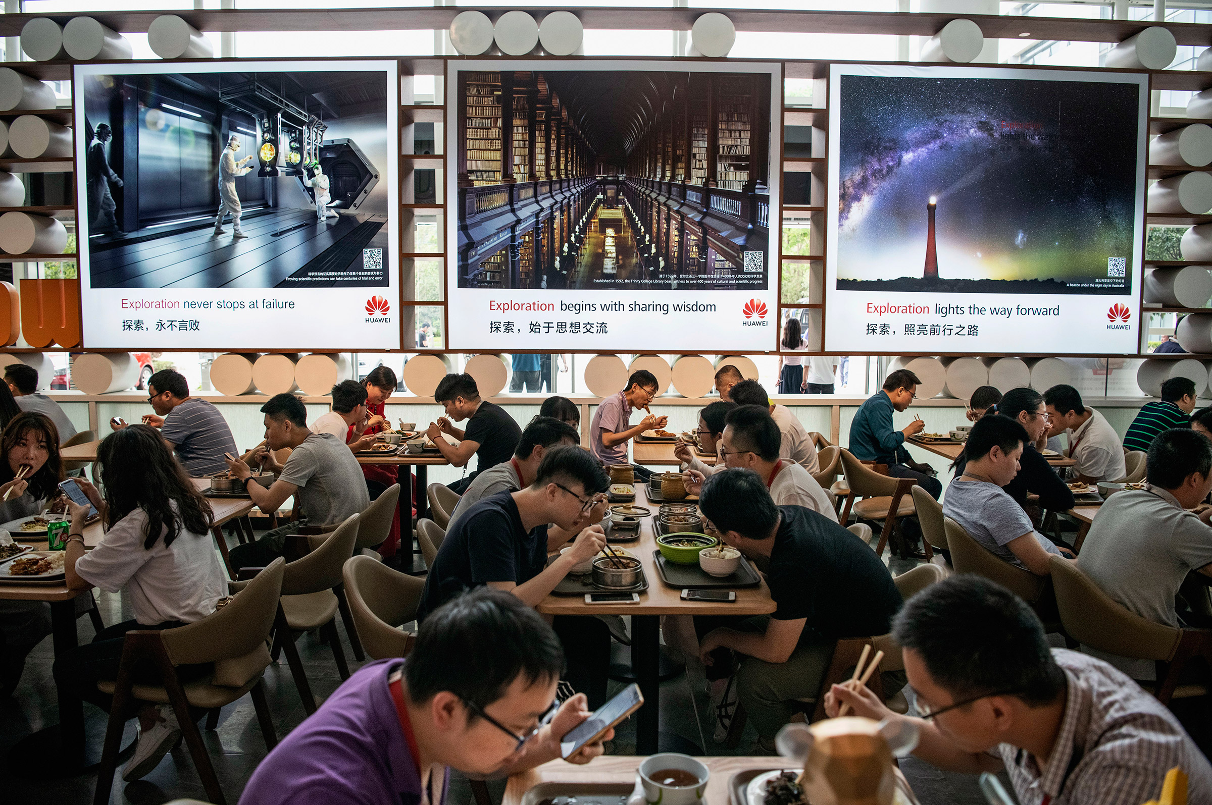 Workers eating lunch at the Huawei campus in Shenzhen, China