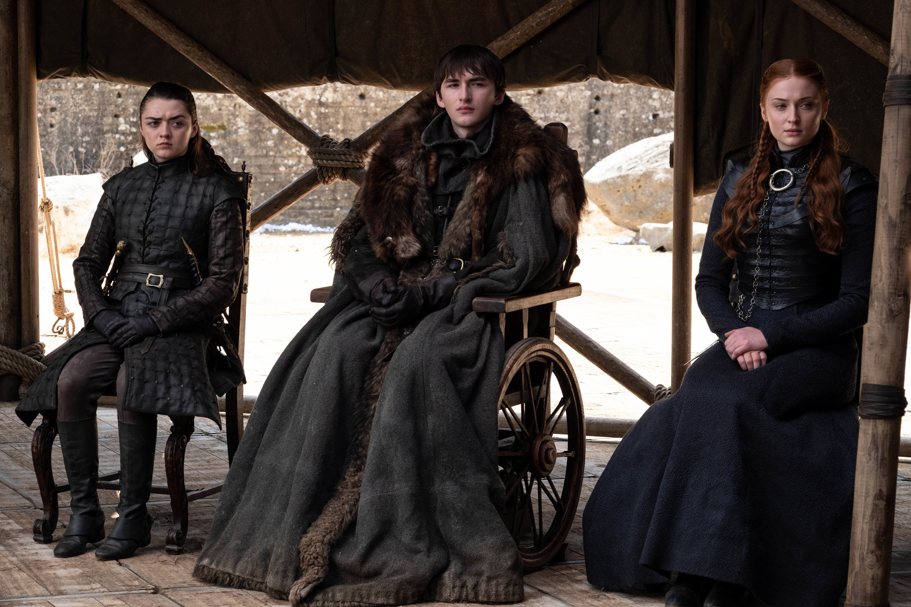 Maisie Williams as Arya Stark, Isaac Hempstead Wright as Bran Stark and Sophie Turner as Sansa Stark in the series finale of Game of Thrones.
