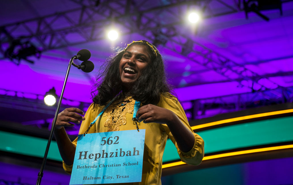 Hephzibah Sujoe, 13, of Fort Worth, Texas reacts after correctly spelling a word in the finals of the Scripps National Spelling Bee on Thursday May 30, 2019 in Oxon Hill, Md.