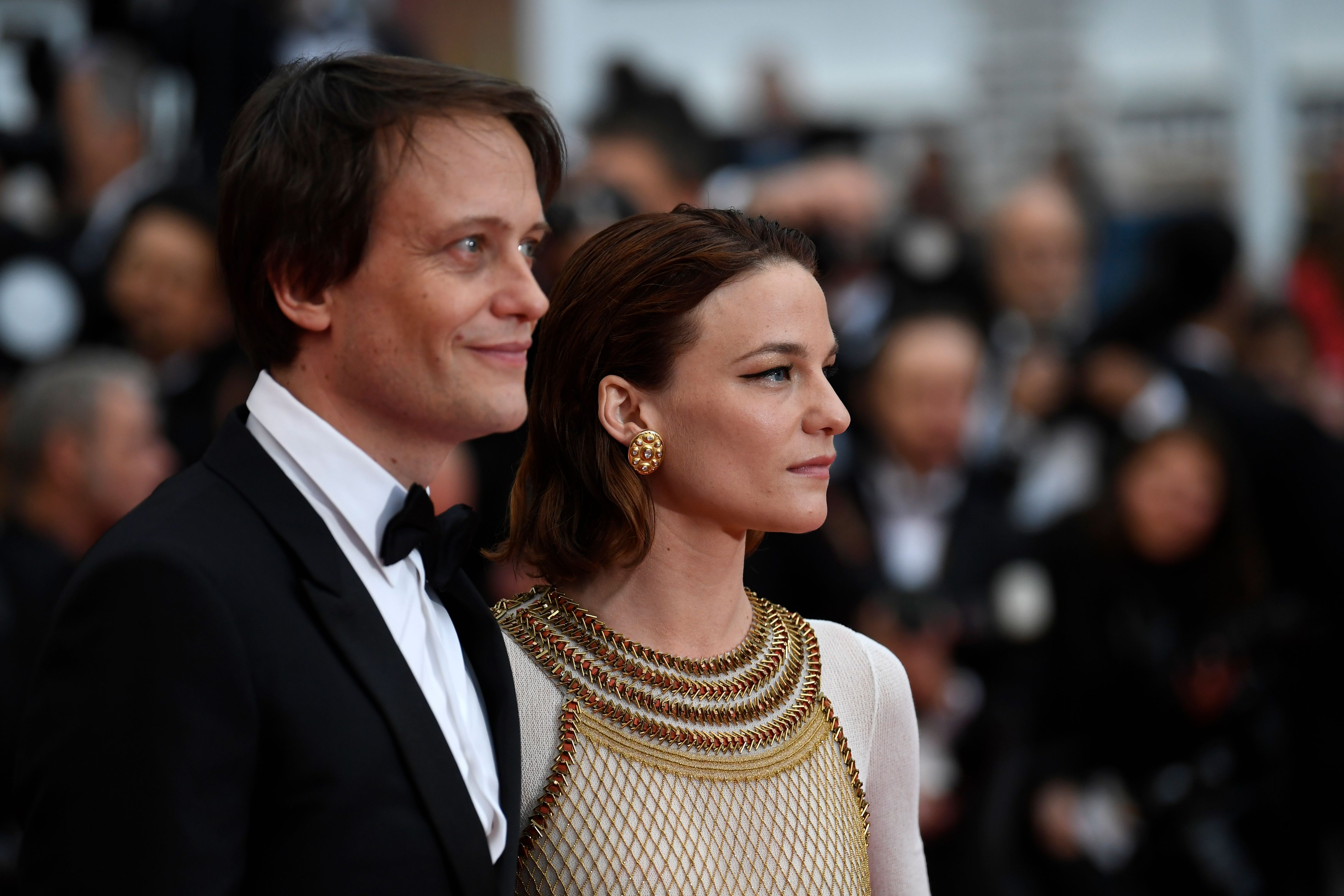 German actor August Diehl and Austrian actress Valerie Pachner arrive for the screening of the film  A Hidden Life  at the 72nd edition of the Cannes Film Festival on May 19, 2019.