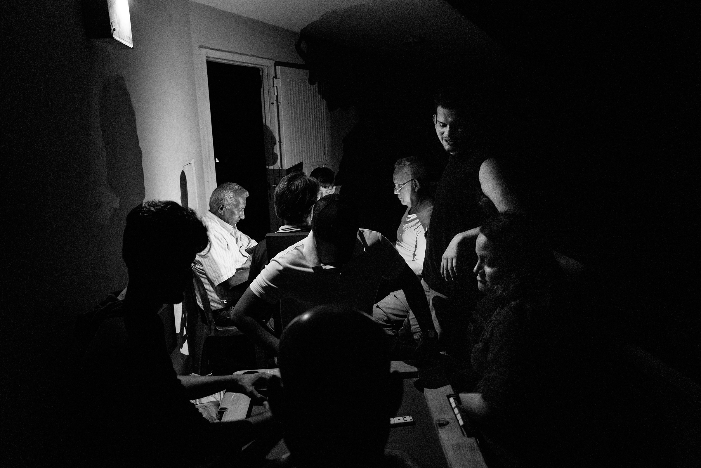 Residents of the Saladillo block of apartments in Maracaibo, after a power cut, on April 12. Venezuela's unprecedented energy crisis left its second largest city without power for long periods in March and April.