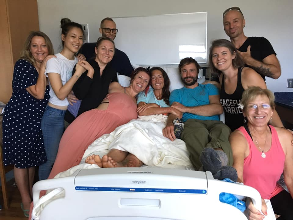 Amanda Eller (center) recovers following more than two weeks lost in the Maui wilderness