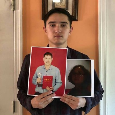 Uighur student Arfat Erkin shows photos of his parents, who were both detained by Chinese authorities in Xinjiang while he was studying in the United States.