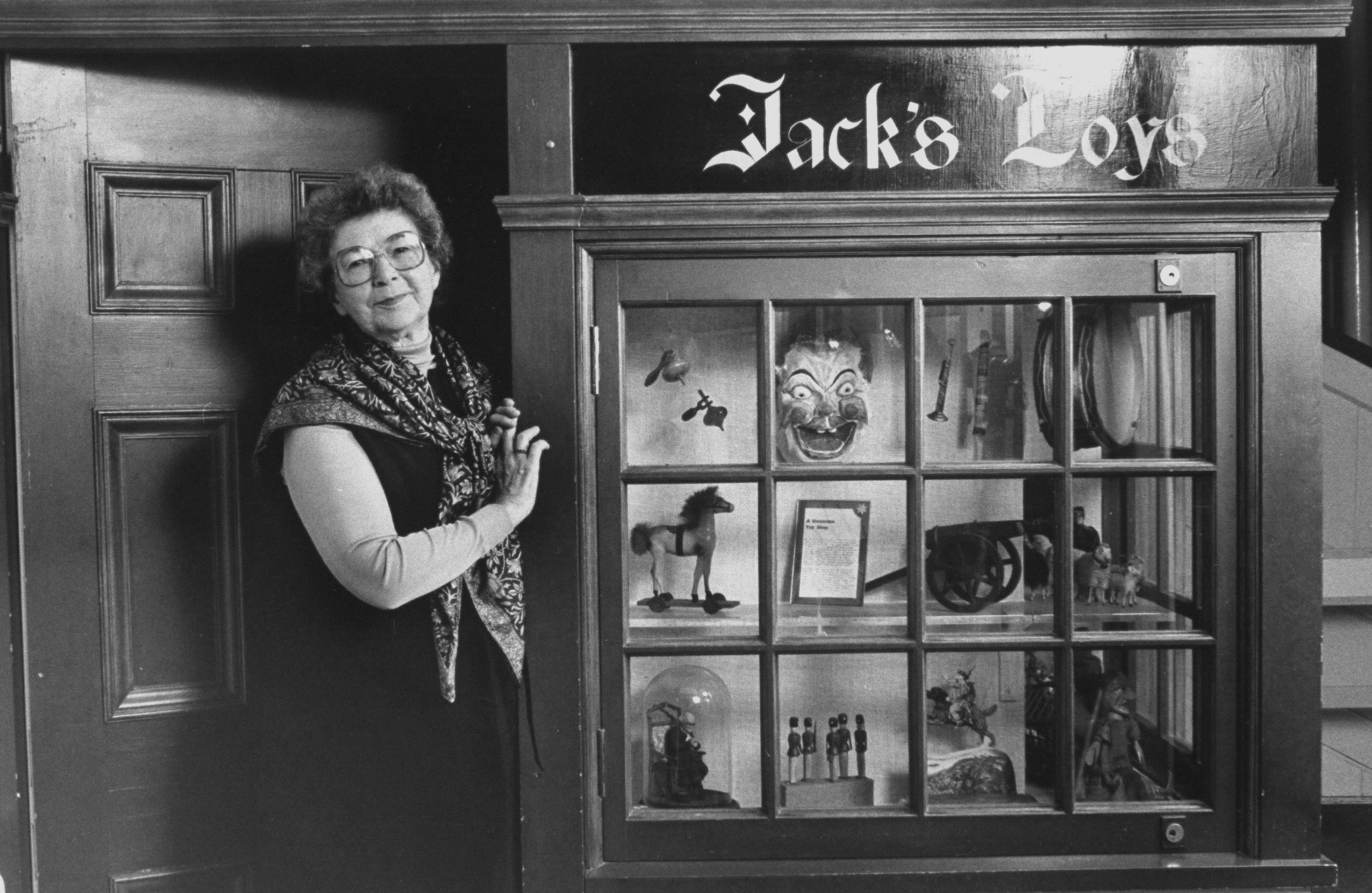 Portrait of children's author Beverly Cleary standing in doorway of Jack's Toys store.