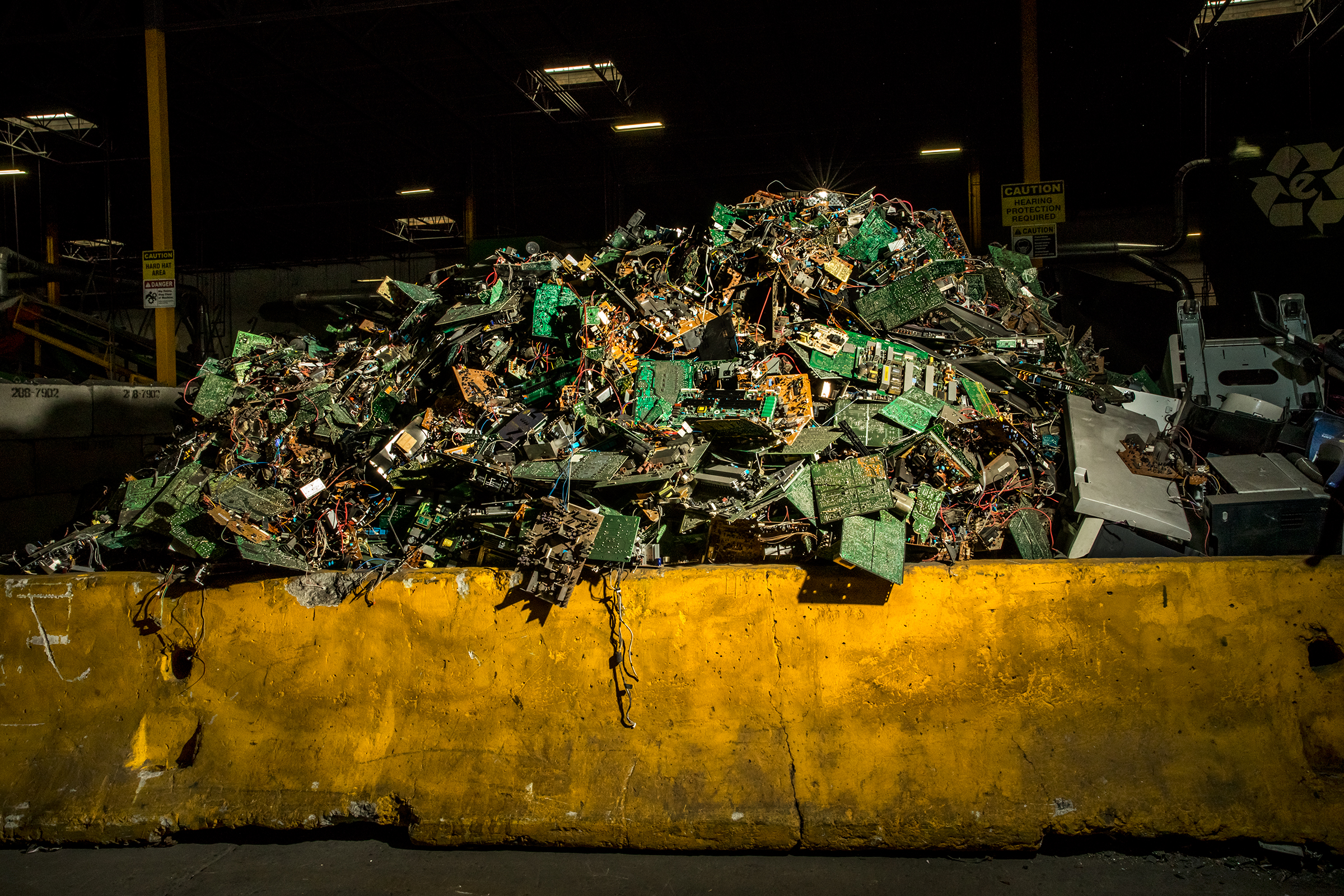 A heaping pile of circuit boards, which can be found in many modern electronics, at ERI's plant in Fresno in May. ERI separates them from their place of origin to be properly broken down and recycled.