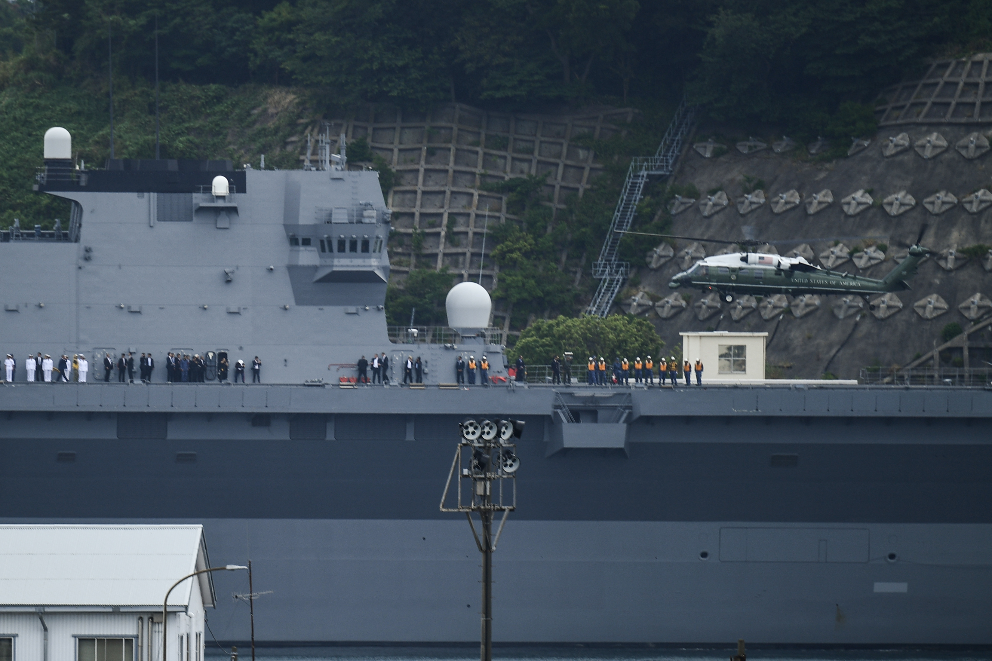 Marine One with US President Donald Trump and First Lady Melania Trump on board lands on Japan Maritime Self-Defense Force helicopter carrier JS Kaga in Yokosuka on May 28, 2019.