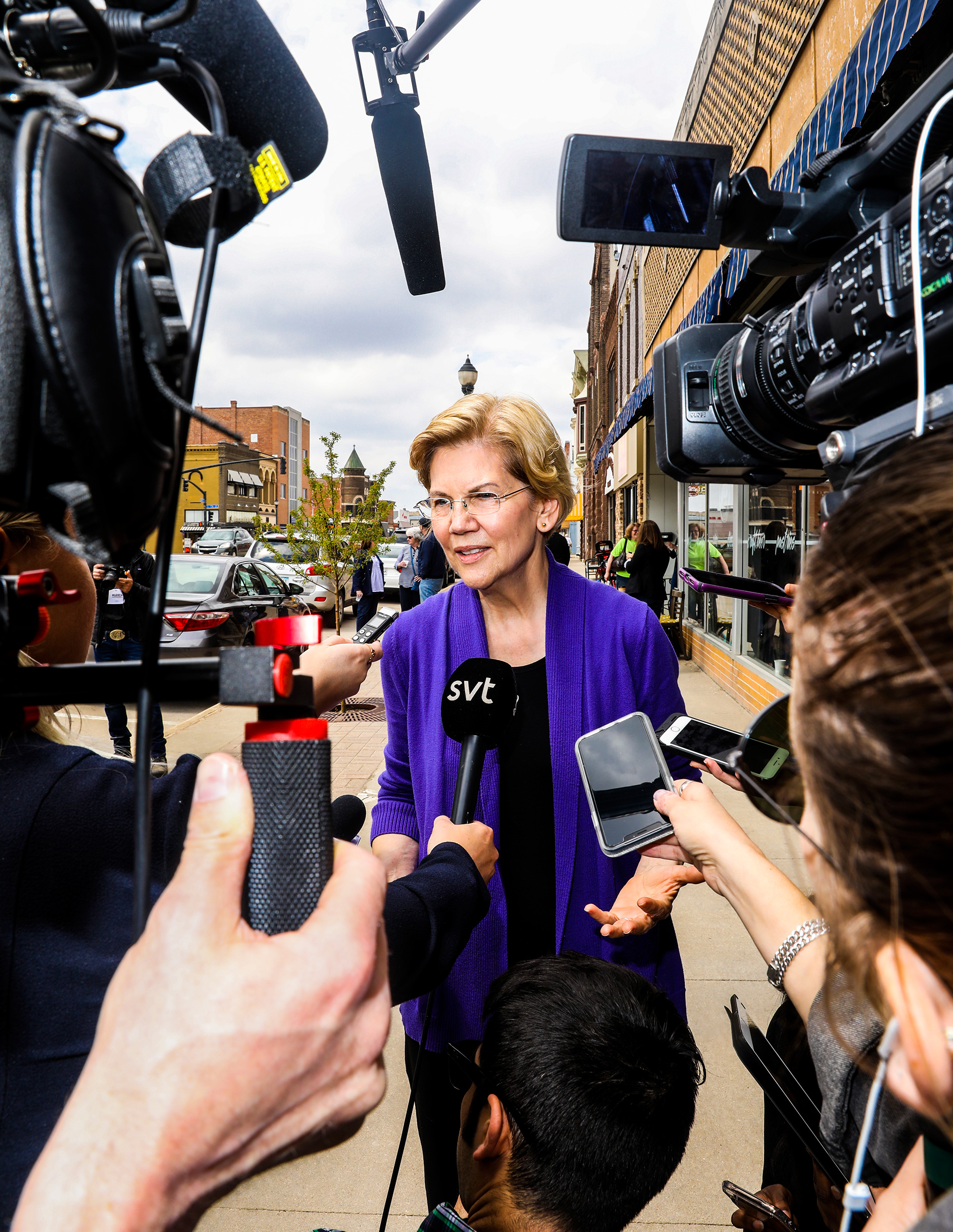 Warren greets members of the press in Osage, Iowa, on May 4.